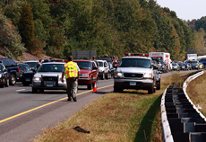 scene of a traffic accident with traffic backed up