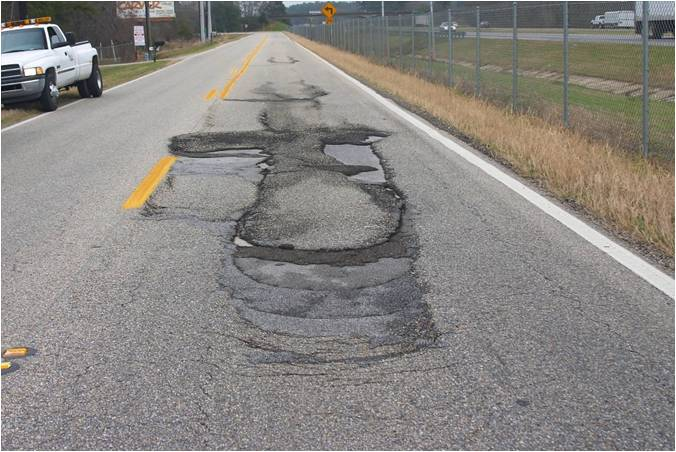 Slippage Failure Due to Poor Bond between Hot-Mix Asphalt Layers